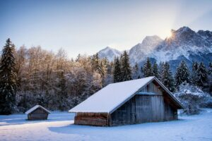 Snowy cabins and mountains